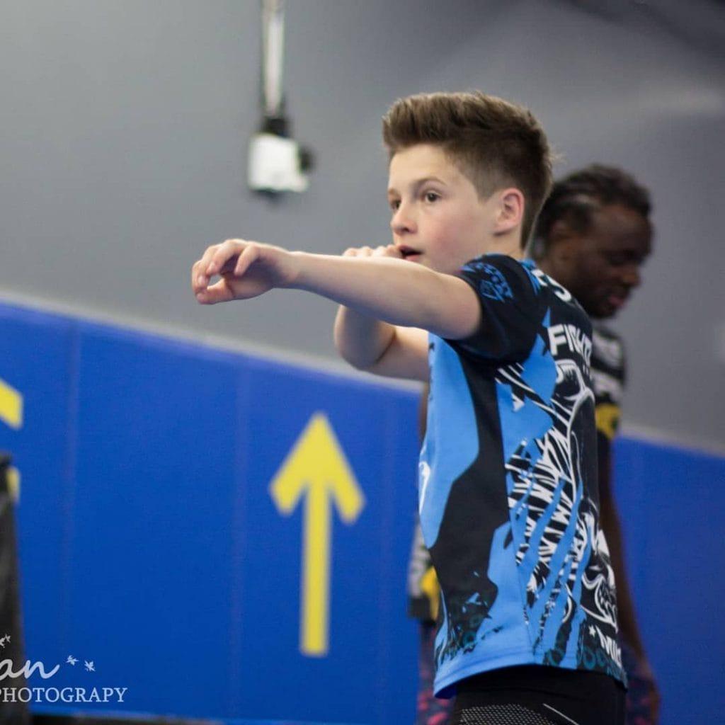 boy boxing in Muay Thai class